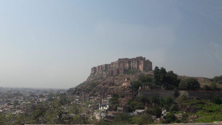 mehrangarh fort towering over the city of jodhpur, rajasthan, india
