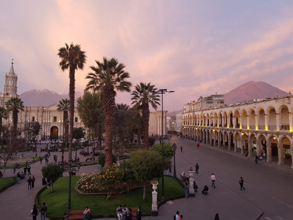 Plaza de Armas of Arequipa at dusk, with El Misti and Chachani volcanoes in the background
